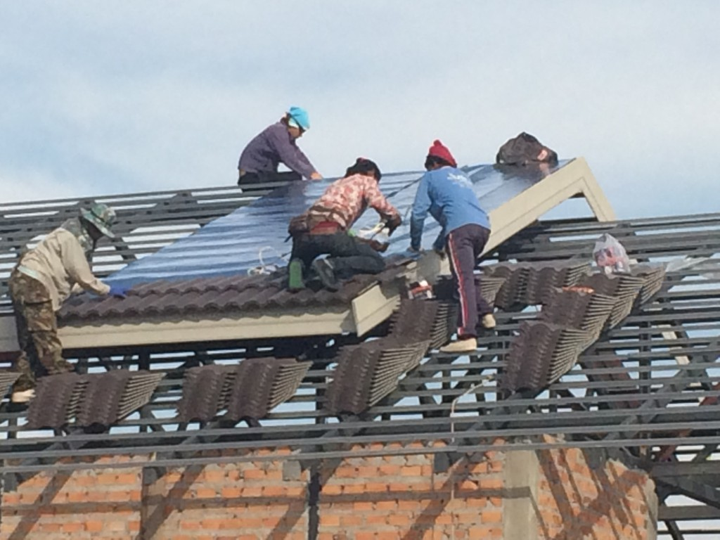 First roof tiles